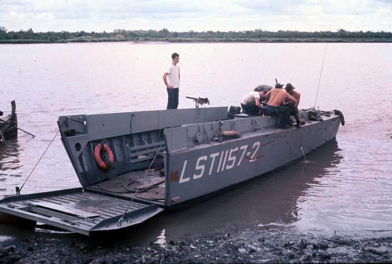 USSTerrellCountyLST-1157LCVP2beachedinVietnam.jpg